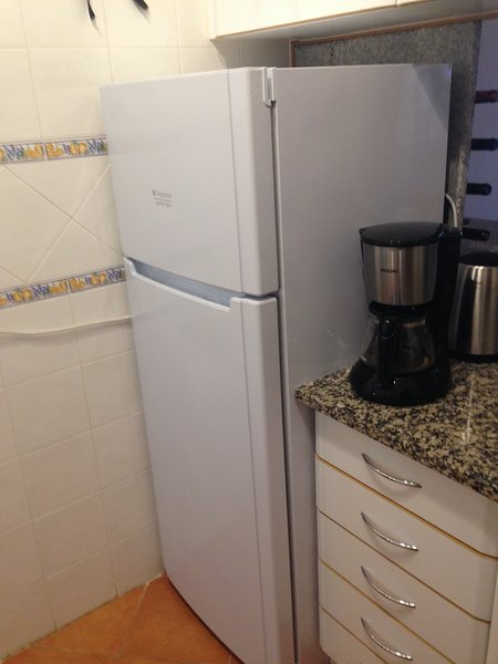 Frige, freezer and very well equipped kitchen