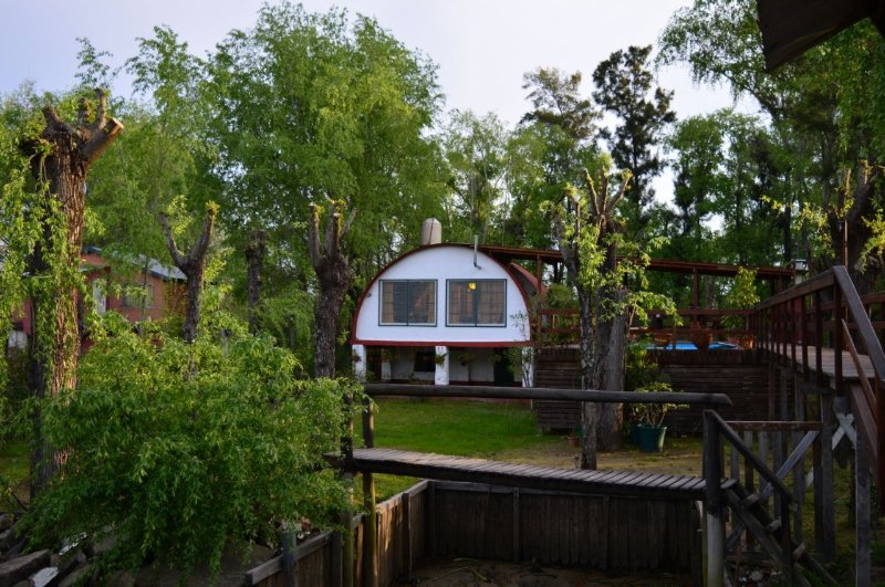 View of the house from the dock on the river