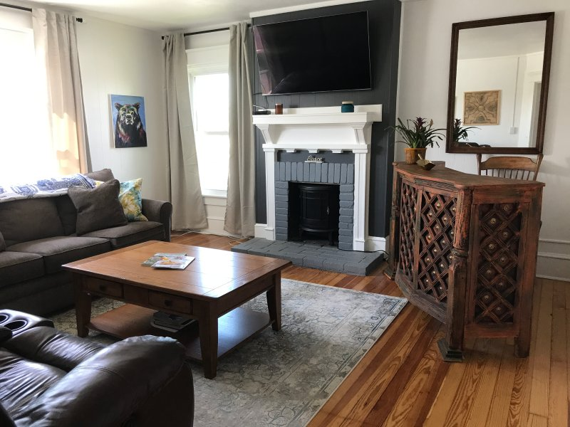 Living Room includes a bar, fake fire place (but looks cool), a 4K TV with all the streaming, Dish
