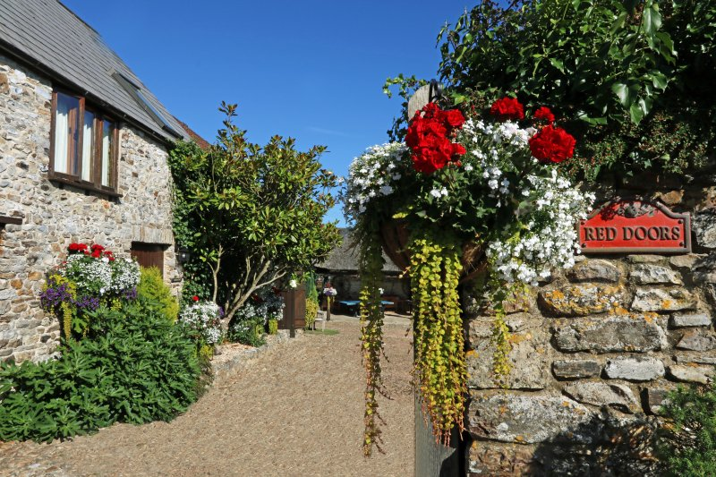 Entrance to Red Doors Farm with Swallows Loft on the left hand side.