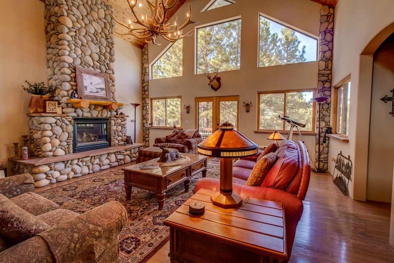 The great room welcomes you with river stone accents, wood beams and more.