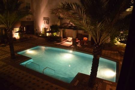 Well lit pool at night.