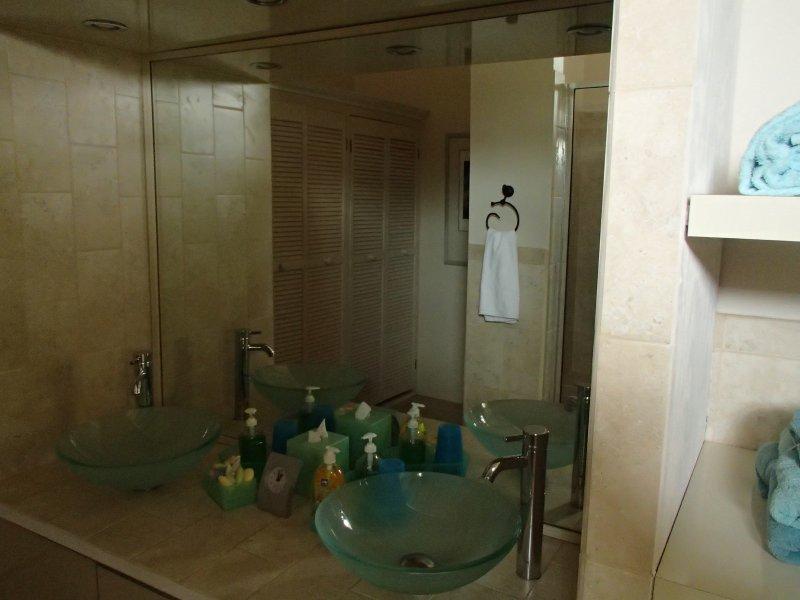 Guest bathroom has double sinks, too