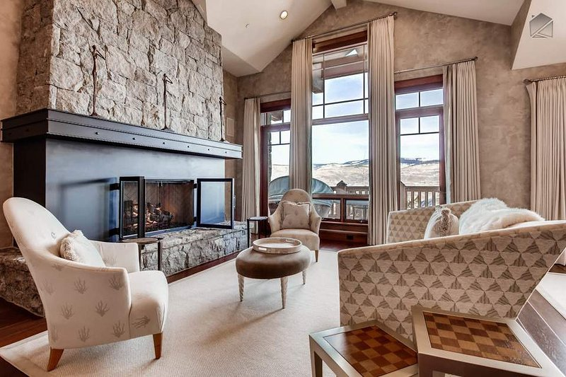 A huge gas fireplace commands the room in the formal living area, which also has a full audio system.