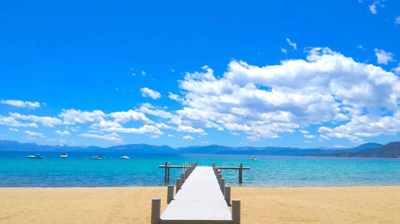 Shared Pier and Sandy Beach on the Shores of Beautiful Lake Tahoe