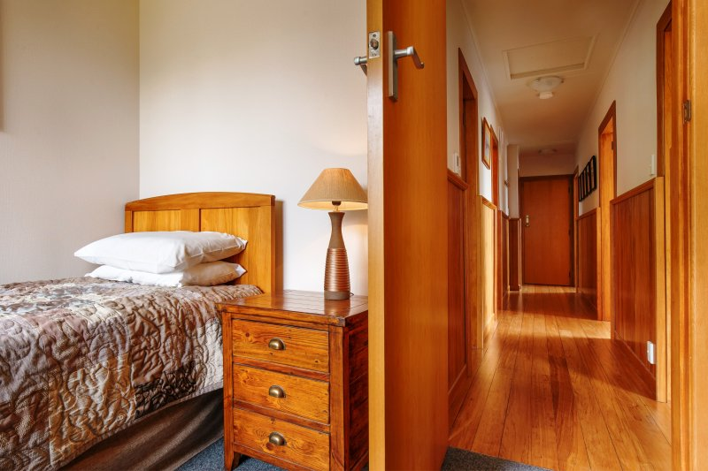 Bedroom four has a long single bed. All bedrooms have large windows, thick curtains and are quiet.