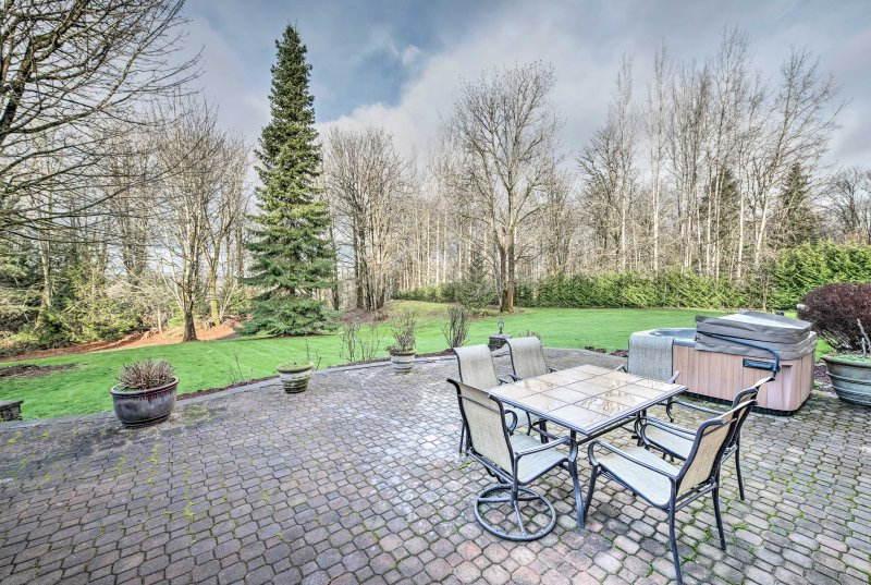 This property offers an expansive patio area and private hot tub!