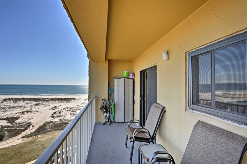 Lounge on the private balcony while enjoying the beachfront views.