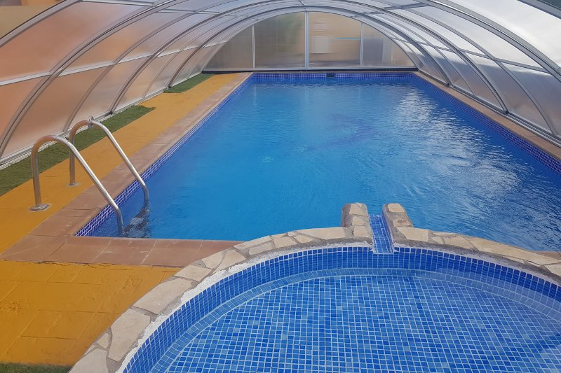 Enclosed pool - Safe for children and ensures pool is very warm year round