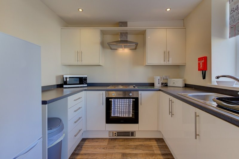 Fully equipped kitchen with cooking utensils, plates and cutlery. Dish cloths provided.