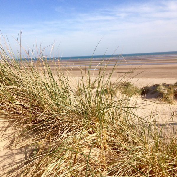 The beach is just a short stroll from Marsh View Cottage in Camber Sands