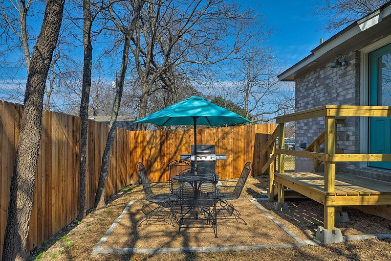 The back yard has outdoor seating for 4 and a gas grill.