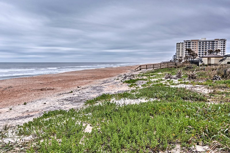 Enjoy sandy adventures just steps from this coastal abode.