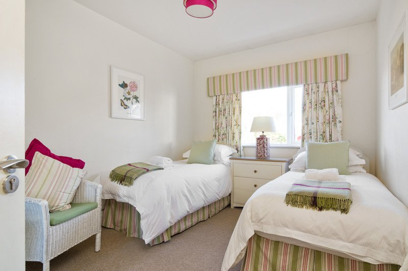 The Cotton Room with twin beds and view over water garden.
