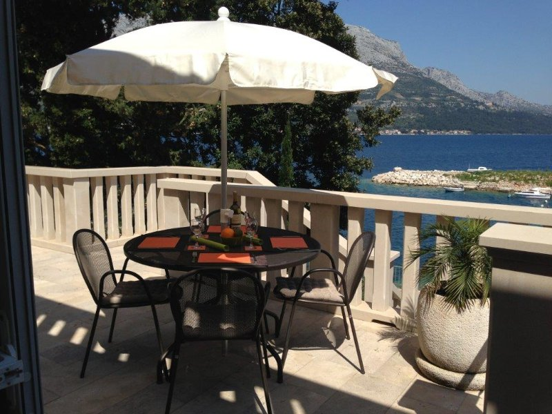 Eating out on the Lower Ground Floor terrace with amazing views of the sea and mountains