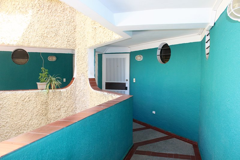 Entrance hall to the apartment, tropical design