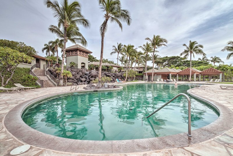 Island paradise awaits at this peaceful 2-bedroom, 2-bathroom vacation rental townhouse in Kamuela!