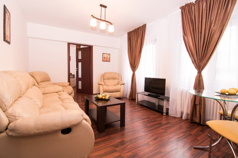 Lovely living room with recliners and small dining area