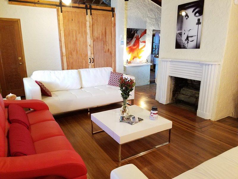 stylish living room with 2 futon white leather sofas (each sleeps 2)