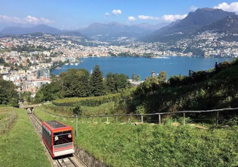 Cosy room in sharing apartment, close to lake/USI and center of Lugano (CH), location de vacances à Lugano