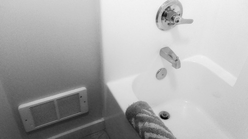 Shower with electric heater and bath mat
