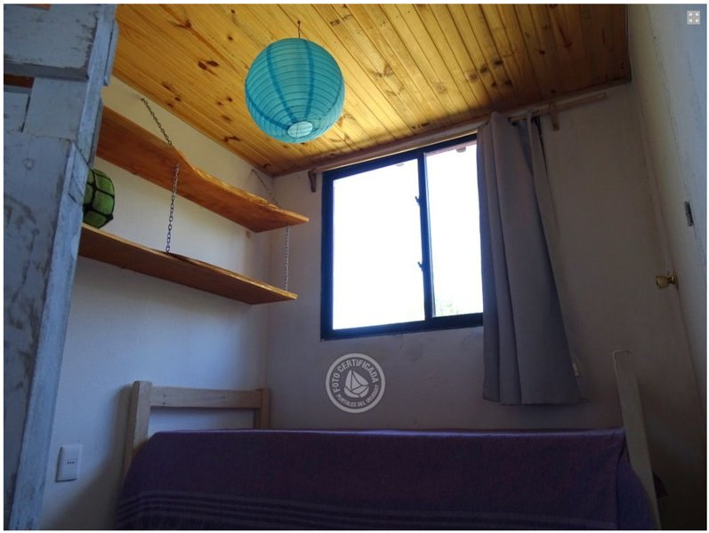 dos camas individuales en el dormitorio de la planta baja
