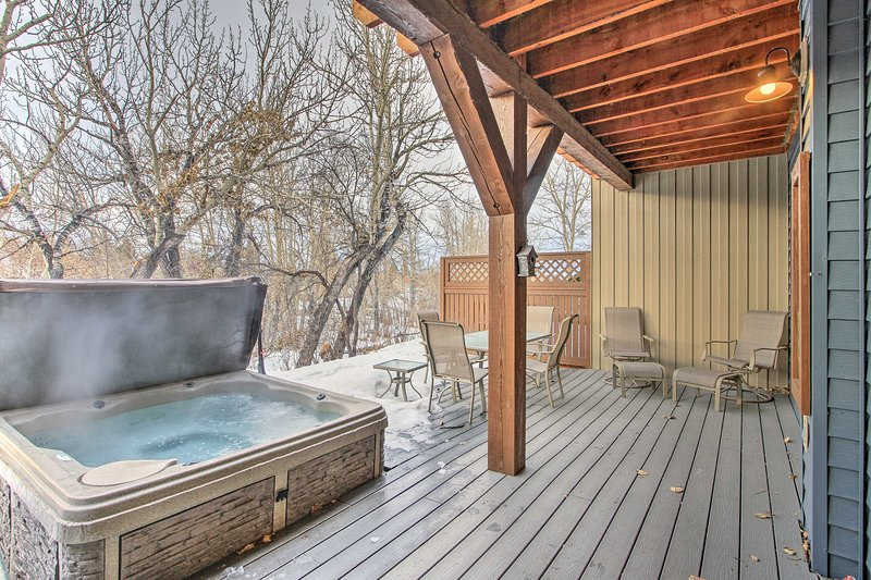 Enjoy scenic views from the covered deck with a 6-person private hot tub.