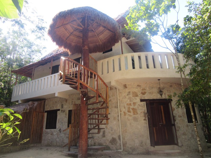 The entrance to the accommodation, which is the whole second floor, is spiral staircase.