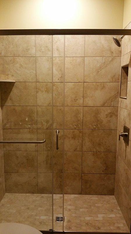 Custom tile shower with glass doors