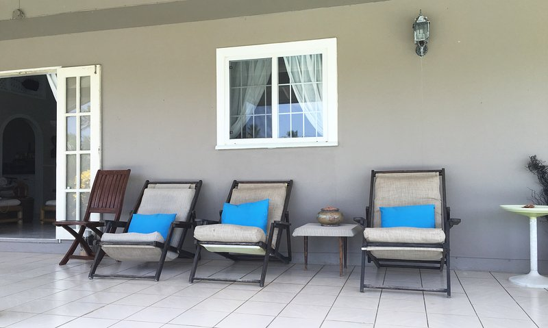 porch with lounge chairs