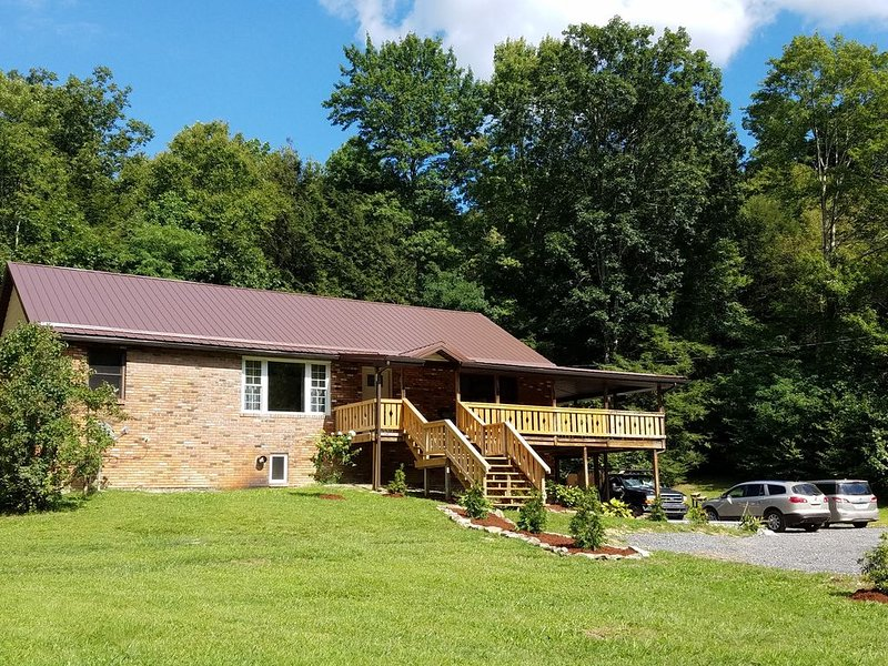 Exceptional Lodging on 14 private acres with a pond, and creek. The ultimate getaway.