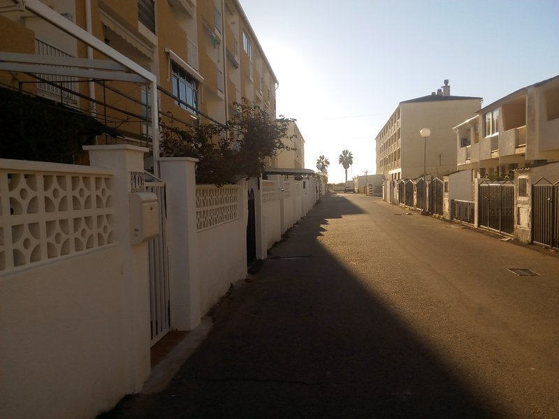Main Street entrance to the apartment complex ... one minute walk from the beach and ...
