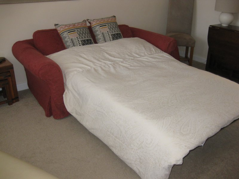 Extensão sofá-cama na sala de estar