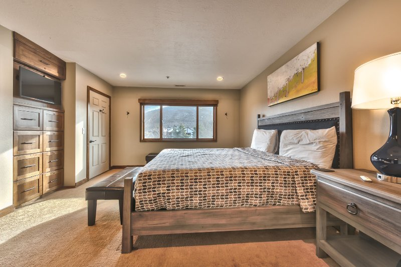 Master Bedroom with King Bed, Flat Screen TV and Private Bath