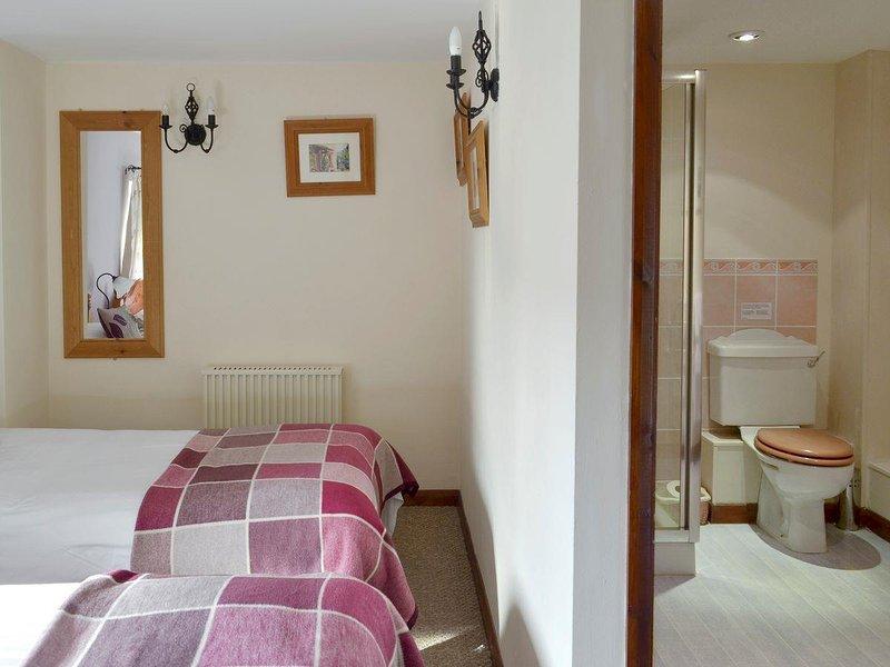 En-suite attaché à chambre avec lit double