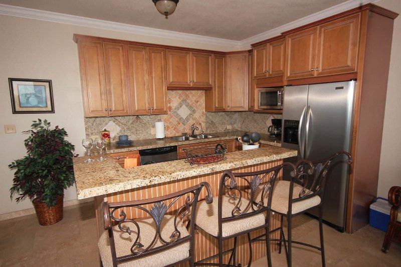 La cocina en los apartamentos inferiores y superiores son idénticos en tamaño y diseño
