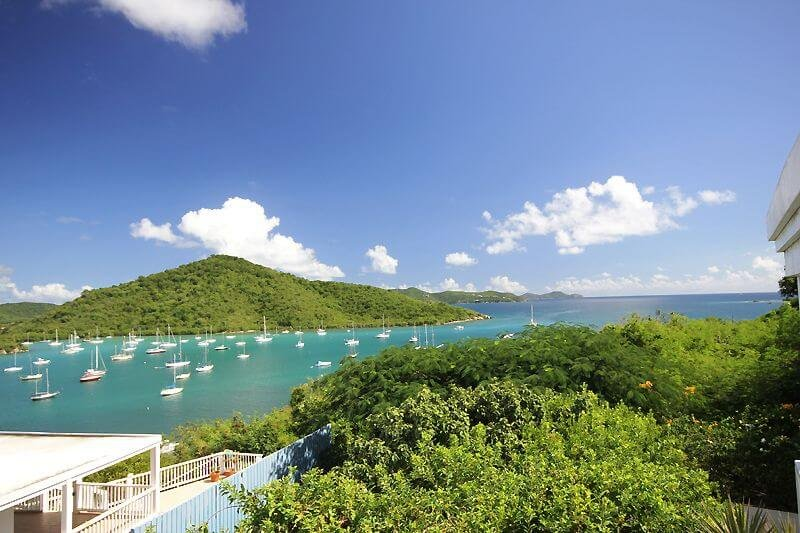 The view from your covered deck overlooks the picturesque harbor of Coral Bay