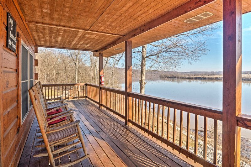 Located just steps from the Ohio River, this 2,200-square-foot cabin has something for everyone.