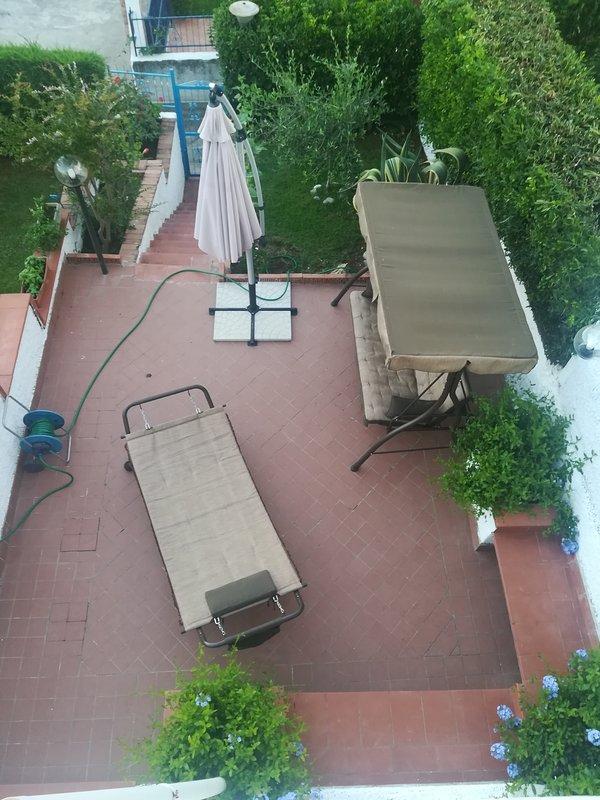 jardim exterior com balanço rede