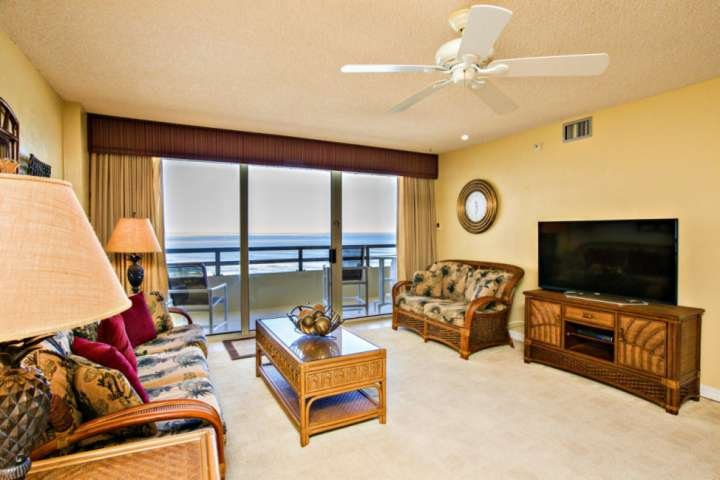 Oceanfront unit with large balcony. Living room features seating for 6 and a 46 inch flat screen cable TV.