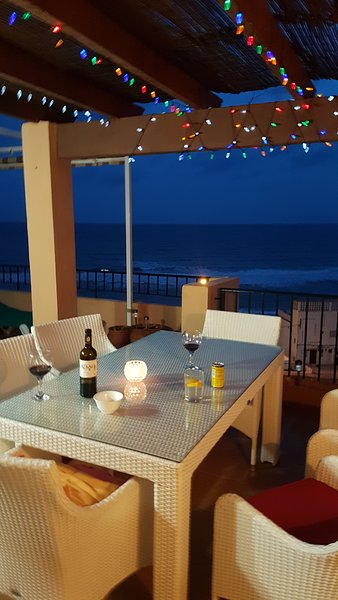 Relax and have a drink or two overlooking the sea