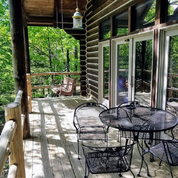 Deee Clan Private Deck with sitting area and swing