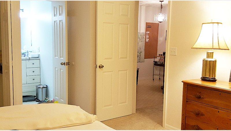 bedroom #4 doorway to living room and kitchen