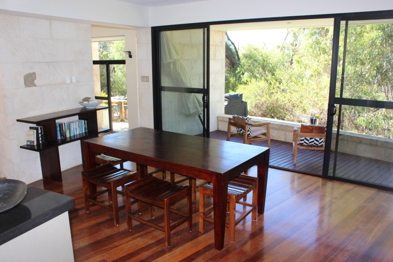 Dining room opening onto private balcony