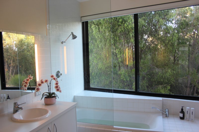 Downstairs bathroom with large bath and beautiful aspect