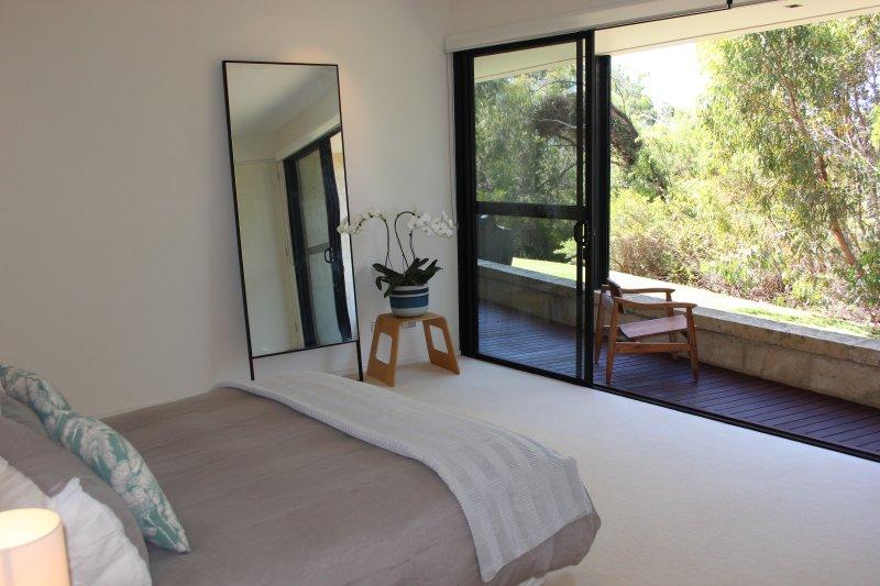 Second bedroom. large opening doors onto balcony.