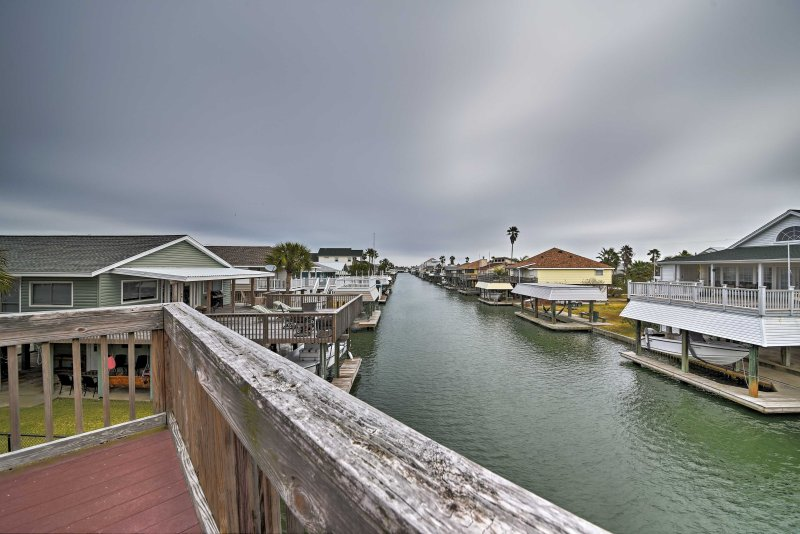 This canal-front paradise boasts 3 decks, a furnished patio, and private dock!