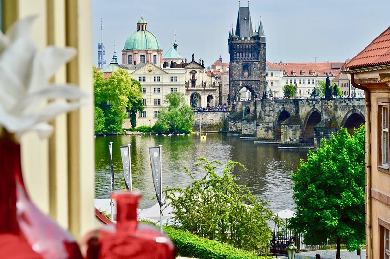 Wake up each morning to this breathtaking view of the Charles Bridge and Vltava river.