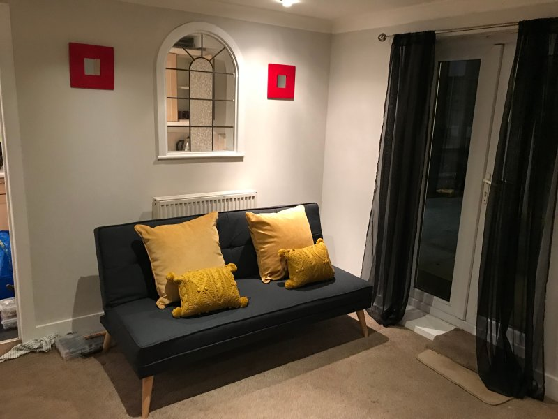 Living room also has two sofa beds for larger parties