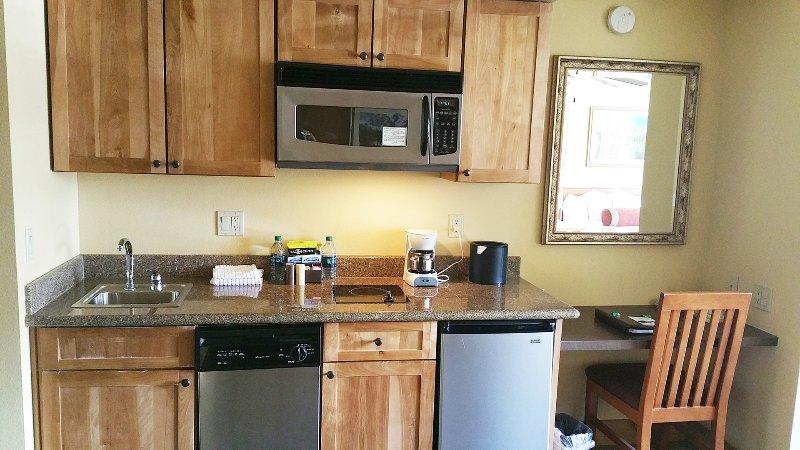 kitchen with microwave, dishwasher, frig and burner